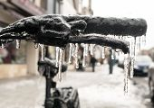 Bicycle Handbars Encased In Ice In Closeup After Ice Storm