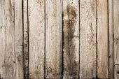 Worn, aged wooden wall on an outdoor barn