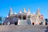 stock photo of hindu  - Religious place of worship BAPS Swaminarayan Sanstha Hindu Mandir Temple made of marble in Lilburn Atlanta - JPG