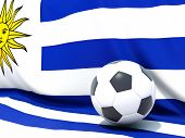Flag Of Uruguay With Football In Front Of It