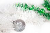 Silvery ball with white and green Christmas tinsel