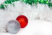 Silvery and red balls with white and green Christmas tinsel