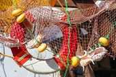 Lifebelt in fishing net with shells above the entrance in the shop.