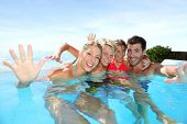 stock photo of infinity pool  - Happy family enjoying bath time in infinity pool - JPG