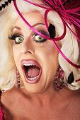 picture of drag-queen  - Singing beautiful Caucasian drag queen close up - JPG