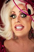 stock photo of drag-queen  - Smiling blond drag queen with big eyelashes - JPG