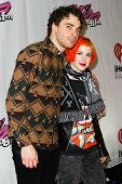 BOSTON-DEC 14: Taylor York (L) and Hayley Williams of Paramore attend KISS 108's Jingle Ball 2013 at