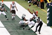 NEW YORK-DEC 22:  Cleveland Browns wide receiver Greg Little (18) leaps as New York Jets defensive b