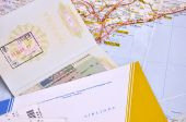 Passport And Air Ticket With Baggage Check Over Map Background. Travel Concept.