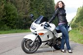 Woman Standing Next To A Motorcycle