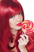 Coloring Hairstyle. Beauty Girl Portrait Holding Colorful Lollipop. Fashion Makeup. Isolated On Whit