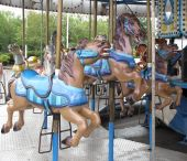 Horses Line Up At A Merry Go Round.