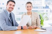 pic of half-dressed  - Smartly dressed young man and woman in a business meeting at office desk - JPG