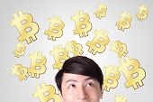 stock photo of bitcoin  - young man happy looking bitcoin business and bitcoin concept - JPG