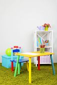 Small and colorful table and chair in room