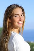 Portrait Of A Beautiful Woman With A White Perfect Smile
