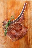 meat food : roast rib on wooden plate with thyme