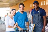 happy young couple shopping at hardware store