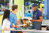 foto of hardware  - couple paying at hardware store till point - JPG
