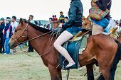 Horseback Girls In Shorts At Nadaam Horse Race