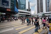 HONG KONG - NOVEMBER 1, 2011: Pedestrians and traffic in Central is the central business district of