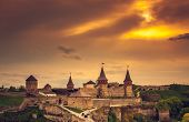 Sunset view on the castle in Kamianets-Podilskyi in spring. Ukraine