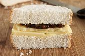picture of home-made bread  - Rustic style hand cut Cheddar cheese and pickle sandwich made with home made bread - JPG