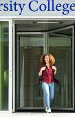 Female Student Leaving College Building