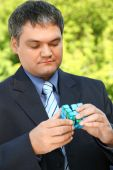 Businessman Keeps In Hand Cube Outdoor In Summer