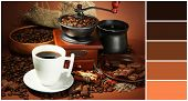 Cup of coffee, grinder, turk and coffee beans on brown background. Color palette with complimentary