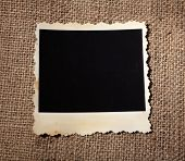 Blank old photo on sackcloth background