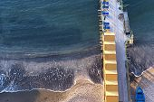 Beach huts and jetty in Sorrento, Campania, Italy