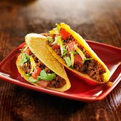 stock photo of tacos  - two beef tacos with cheese - JPG