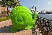 Green Snail On The Street Of Riga, Latvia