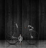 Classic fixed gear bicycle on black wood background