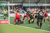 THE HAGUE, NETHERLANDS - JUNE 2: New Zealander Grant is trying to score a�?� goal on the Korean s