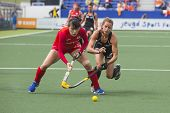 THE HAGUE, NETHERLANDS - JUNE 2: New Zealander Webster is trying to take the ball from Korean Lee du