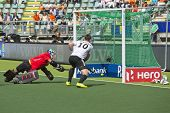 THE HAGUE, NETHERLANDS - JUNE 1: German field hockey player Wesley races in for the rebound on Strai