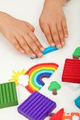 Child hands with modeling clay - closeup