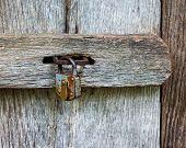 The Metal Lock On A Wooden Door