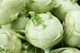 stock photo of turnip greens  - Large kohlrabis or turnips shot from above - JPG