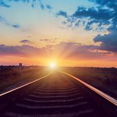 sunset over railroad to horizon