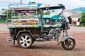 Nong Khai, Thailand - May 1 : Motor Tricycle Parks Near The Road To Laos Frontier On May 1 , 2009 In