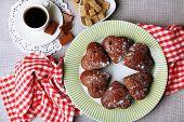 Homemade chocolate cupcakes on table