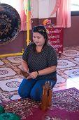 Bangkok, Thailand - January 1 : Unidentified Woman Shake A Chi-chi Sticks For Predicton