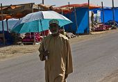 Arab Man with an umbrella