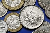 Coins of France. Olive and oak branches depicted in the old five French franc coin.