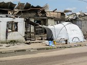 A Disaster Relief Tent Erected Next To A Badly Damaged Tent In Brazzaville Congo