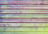 Section of colorful wood panel fence for backgrounds