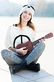 Young woman playing ukulele
